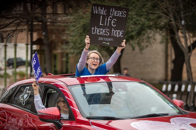 Opponents of abortion rights gathered near the Texas Capitol on Saturday for the 2021 Texas Rally for Life, calling for an abortion ban and protesting the U.S. Supreme Court's Roe v. Wade decision on Jan. 22, 1973, that established a legal right to the procedure. The rally included a car caravan, with participating vehicles decked out in pro-life messages and anti-abortion slogans.