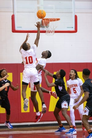 Clarke Central's Justin Hodges (10) scores in the game's last seconds to force overtime during a boys high school basketball game between the Cedar Shoals Jaguars and the Clarke Central Gladiators at Clarke Central High School. (Casey Sykes for The Athens Banner-Herald)