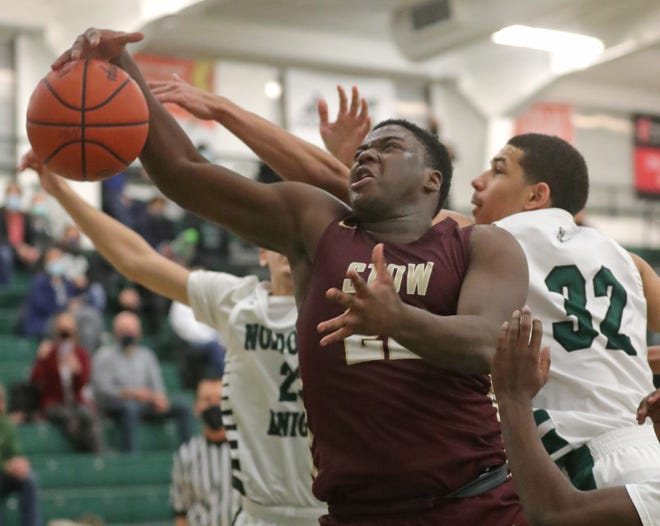 Stow's Desmond Copeland grabs a third quarter rebound between Nordonia's Liam Gopalakrishna, left, and Vincent McFarland on Friday, Jan. 22, 2021 in Macedonia, Ohio. [Phil Masturzo/ Beacon Journal]