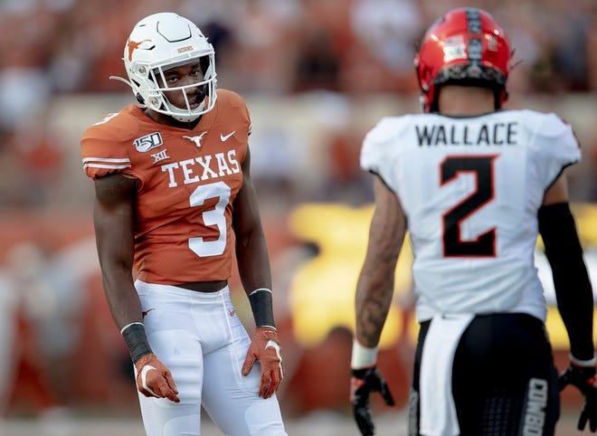 Texas cornerback Jalen Green (3) stares down Oklahoma State receiver Tylan Wallace (2) on Sept. 21, 2019, in Austin.