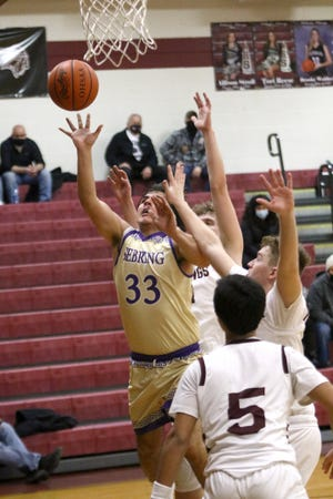Sebring's Frankie Lozoya led the Trojans with 14 points in their game against Lowellville on Friday night.