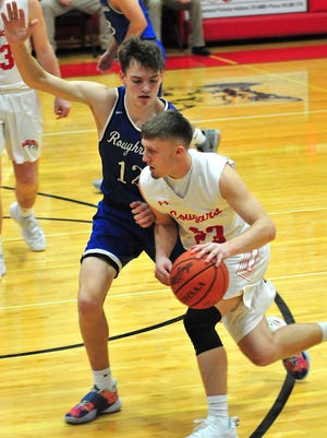 Crestview's Evan Hamilton (23) drives the ball past Western Reserve's John Skrada (12) during high school boys basketball action Friday at Crestview High School. The Cougars lost, 70-44.