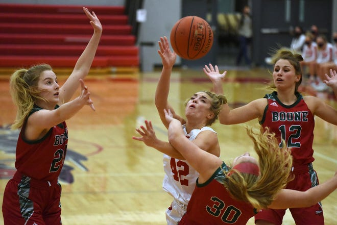 Ballard's Molly Ihle puts up a shot against Boone's Emma Dighton (30) as the Toreadors' Emmy Lewis (left) and Emily Ades come in for support Friday at Huxley. Ihle anchored an amazing Bomber defensive effort that held Boone to 3 of 27 shooting from the field and she also scored six points and pulled down eight rebounds to help No. 2 (4A) Ballard trounce the No. 13 Toreadors, 39-17.