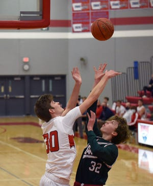 Ballard's Kade Miller blocks a shot by Boone's Nathaniel Winter during the second half of the No. 4 (3A) Bombers' 70-35 victory over the Toreadors Friday in Huxley. Miller scored 10 points off the bench to help Ballard move to 11-1.