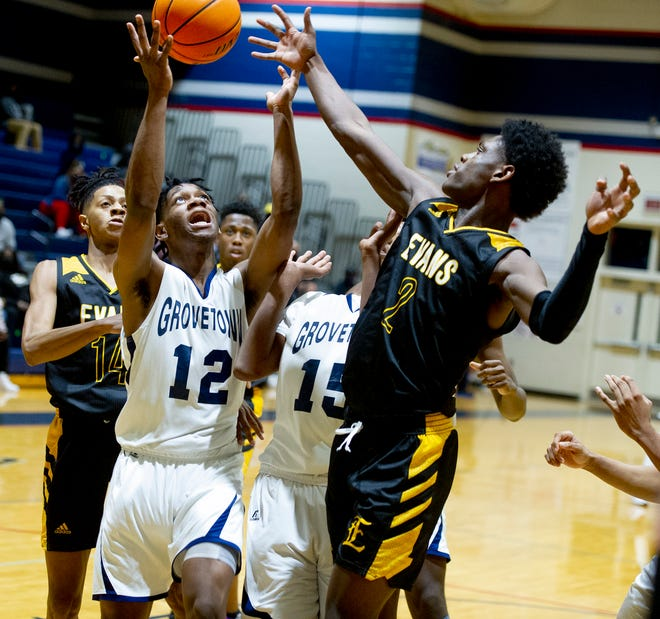 Markel Freeman of Grovetown, left, battles with Brasen James of Evans for a rebound at the high school basketball game between Evans and Grovetown on January 22, 2021 in Grovetown, Ga. [MIKE ADAMS FOR THE AUGUSTA CHRONICLE]