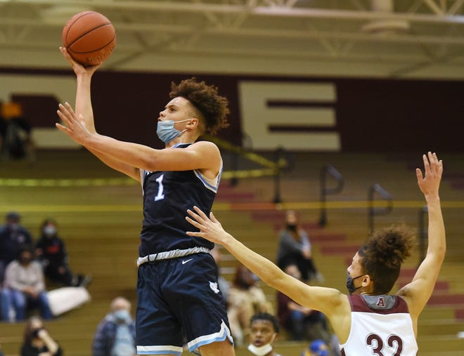 Central Valley's Jayvin Thompson shoots  ahead of Ambridge's Brian Frederick  during Friday night's game at Ambridge.
