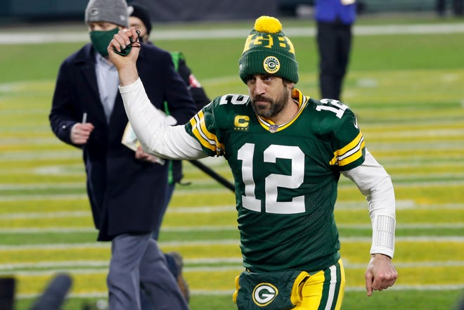 Green Bay quarterback Aaron Rodgers pumps his fist after a playoff win against the Los Angeles Rams on Jan. 16.
