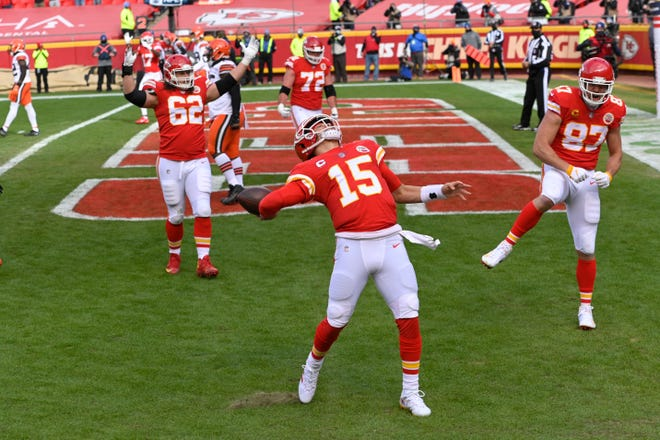 Kansas City Chiefs quarterback Patrick Mahomes (15) celebrates after scoring on a touchdown run during an NFL divisional-round playoff game against the Cleveland Browns last Sunday in Kansas City.