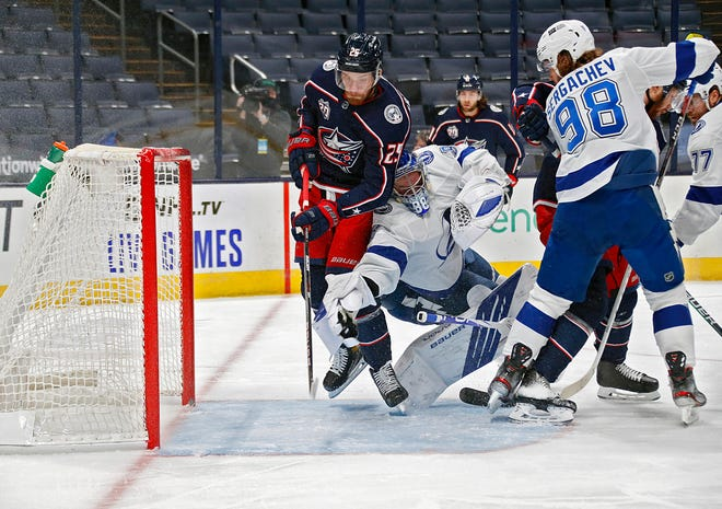 Mikhail Grigorenko scores a goal against Lightning goaltender Andrei Vasilevskiy to give the Blue Jackets a 2-1 lead in the first period at Nationwide Arena.