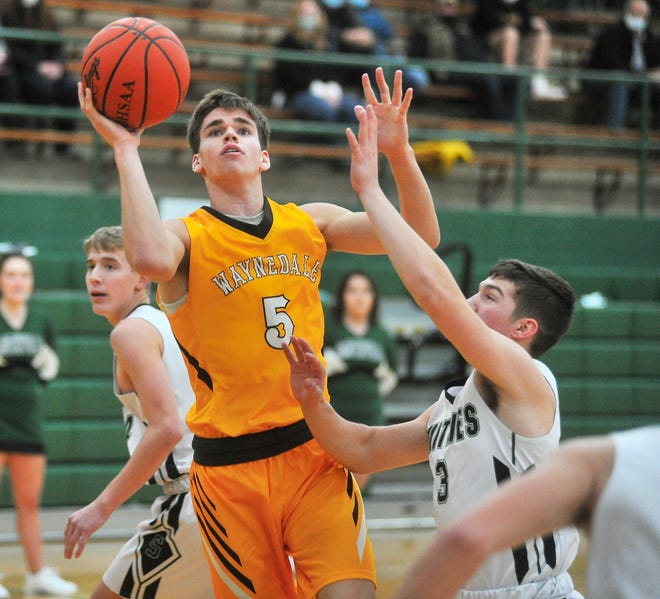 Waynedale's Zach Geiser (5) goes up for a layup during a high school boys basketball game against Smithville on Friday night. The Golden Bears picked up a 46-29 win over the Smithies.
