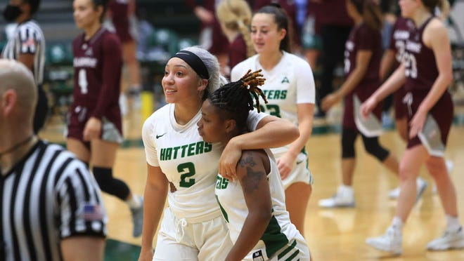 Stetson senior Tonysha Curry (2) leads the celebration as the Hatters rallied to defeat visiting Bellarmine, 71-67, to win an ASUN Conference game Saturday, Jan. 23, 2021, in DeLand. Curry led Stetson with a career-high 16 points.