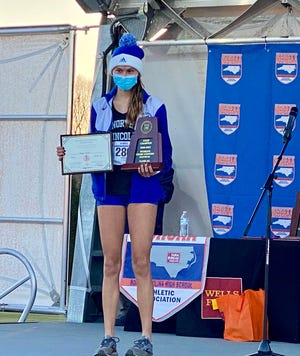 North Lincoln's Angie Allen after taking the Class 2A girls cross country state title as an individual. Her team also earned top billing by winning a state title. [Contributed photo/NCHSAA]