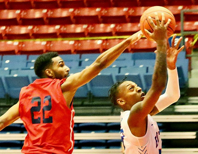 Hutchinson Community College's Josh Baker (13) shoots past Seminole State's Jaylen O'Connor (22) during their season opener game Friday night at the Sports Arena. HCC defeated Seminole State 87-71.