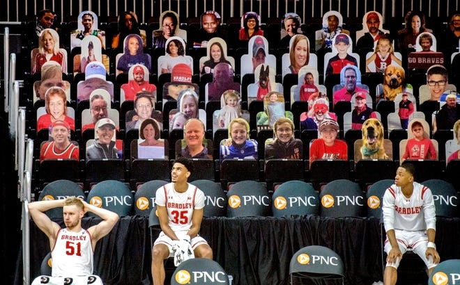Dozens of cardboad cutouts of friends, fans and family members line one side of the stands during a recent Bradley men's basketball game at Carver Arena.