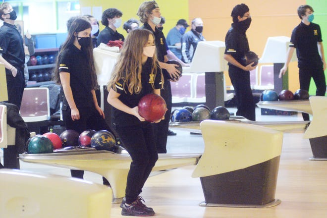 Members of the Newton High School bowling team prepare for the home opener against Salina South at Play-Mor Lanes.