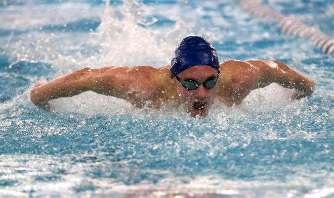 Hudson senior Seth Baylor swims the 100 butterfly during the Explorers' 119-61 win over Stow-Munroe Falls Friday at the Ada Cooper Miller Natatorium. Baylor won the 100 butterfly in 58.91 seconds.