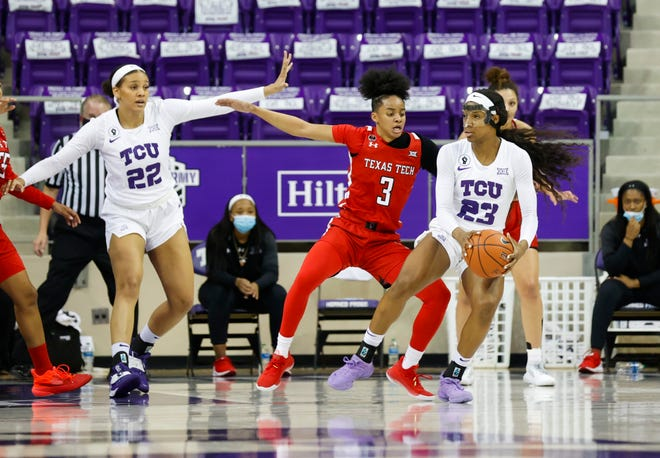 Texas Tech guard Maka Jackson defends TCU's forward Michelle Berry during a Big 12 Conference game Saturday at Schollmaier Arena in Fort Worth. Jackson finished with a season-high 11 points to go with seven rebounds in the Lady Raiders 61-53 loss. [Sharon Ellman/TCU Athletics]