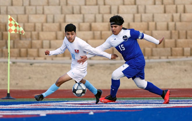 Monterey's Jose Ortiz Cruz (10) and Estacado's Jimmy Bolonas (15) run after the ball during the match against Estacado, Friday, Jan. 22, 2021, at PlainsCapital Park at Lowrey Field in Lubbock, Texas.