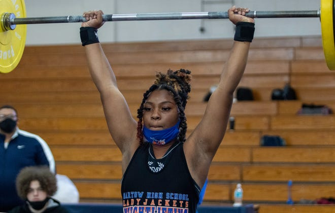 Bartow's Trinity Fuery completes her lift in the clean-and-jerk in the 169-pound division on Saturday at the Class 3A, District 10 girls weightlifting meet at Winter Haven High School.
