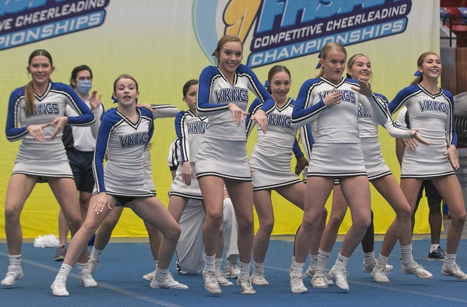 Lakeland Christian School cheerleaders compete on Friday in the Small Non-Tumbling division during the FHSAA Class 1A Competitive Cheer State Championships at The RP Funding Center.