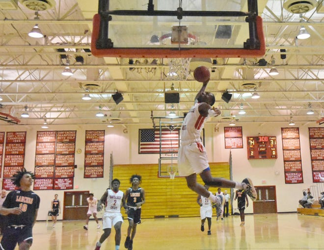 Santaluces senior Justin Roseme rises for a dunk attempt during the Chiefs' 89-45 win.