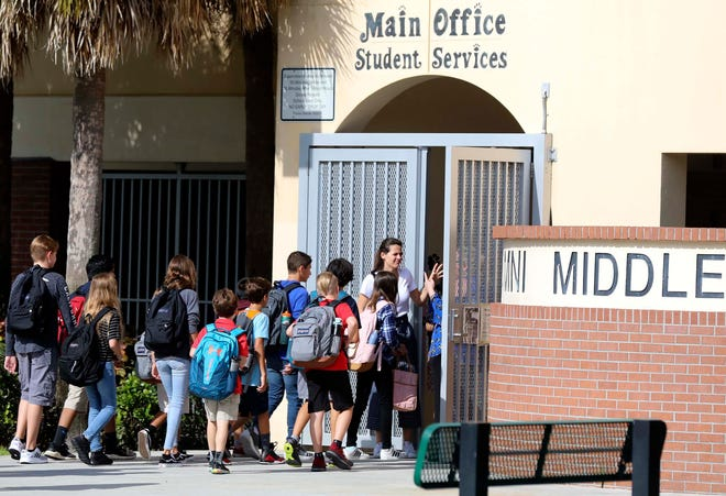 Students enter Omni Middle School in Boca Raton on the first day of school in 2018, which that year was on Aug. 13. BRUCE R. BENNETT / PALM BEACH POST