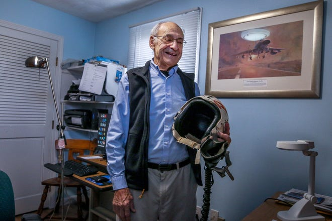 """Veteran pilot Onofrio """"Niffy"""" Andrews in his Bristol home. On his wall hangs a painting of an F-100D, the plane he called his """"office."""""""