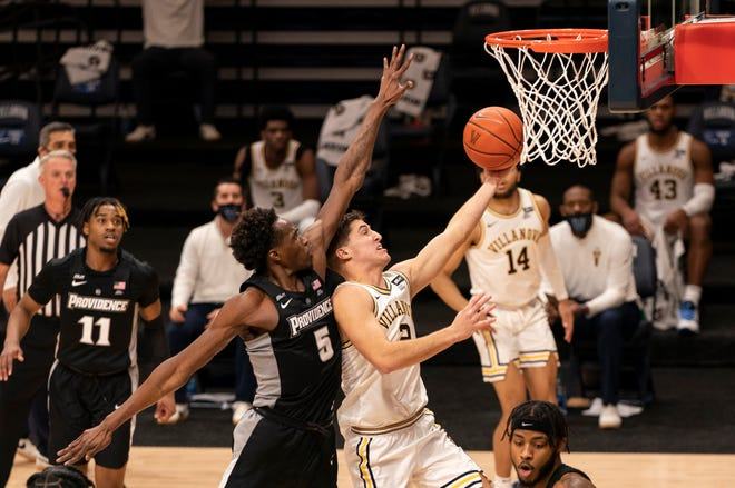 Villanova's Collin Gillespie goes up for a shot past Providence's Jimmy Nichols during the second half of Saturday's game. The Wildcats outscored the Friars, 47-29, after the intermission en route to the victory.