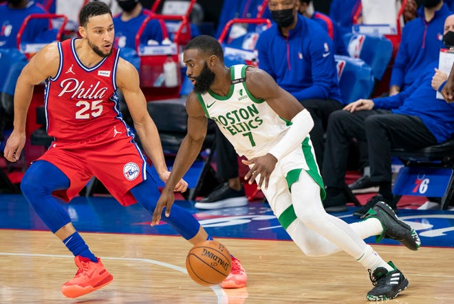 Boston's Jaylen Brown, right, drives to the basket against Philadelphia's Ben Simmons, left, during the first half of Friday night's game.