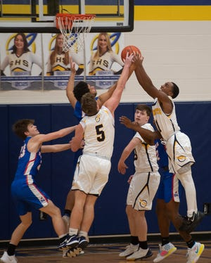 Streetsboro hosted Ravenna with the Rockets taking the win 54-45. Players try to grab a rebound.