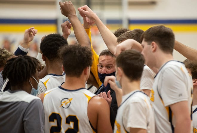 Streetsboro hosted Ravenna with the Rockets taking the win 54-45. Streetsboro head coach, Nick Marcini, talks to his team during a stop in play.