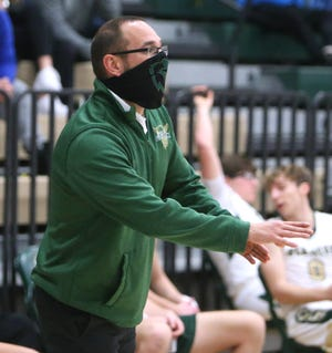 GlenOak head coach Matt Hackenberg issues instructions to his players during a game against McKinley on Friday, Jan. 22, 2021.