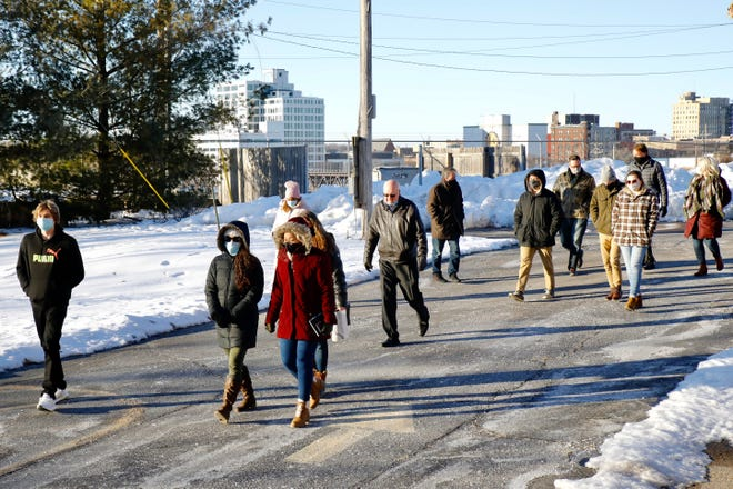 A group of Judson University architecture students walks on a tour Friday of a southwest Rockford neighborhood that students will work on plans to revitalize.