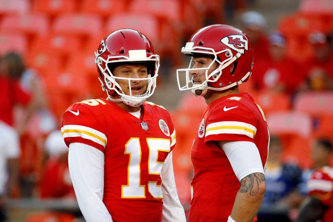 Kansas City Chiefs quarterbacks Patrick Mahomes (15) and Chad Henne chat before an Aug. 30 preseason game in Kansas City. Mahomes was cleared to play against the Buffalo Bills in Sunday's AFC championship game after passing NFL concussion protocols.