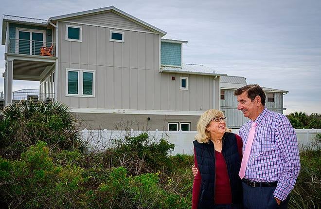 Barbara and David Goldberg stand in the back yard of their beach-front home, north of Crescent Beach, on Jan. 22, 2021. The Goldbergs are concerned that large parties being held a vacation rental home next door to then are hurting their quality of life.