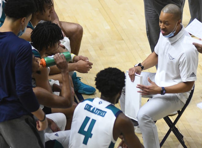 UNCW coach Takayo Siddle has had a bumpy ride during his debut season as head coach, with seven players injured and 11 games canceled because of COVID-19. [MATT BORN/STARNEWS]