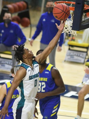 UNCW's Ty Gadsden, shown here against Delaware in January, had his streak of 50 consecutive made free throws end Saturday night.