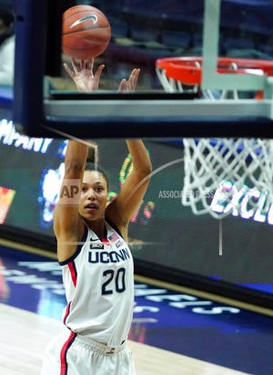 Connecticut forward Olivia Nelson-Ododa (20) shoots against Georgetown during an NCAA college basketball game Saturday, Jan. 23, 2021, in Storrs, Conn.