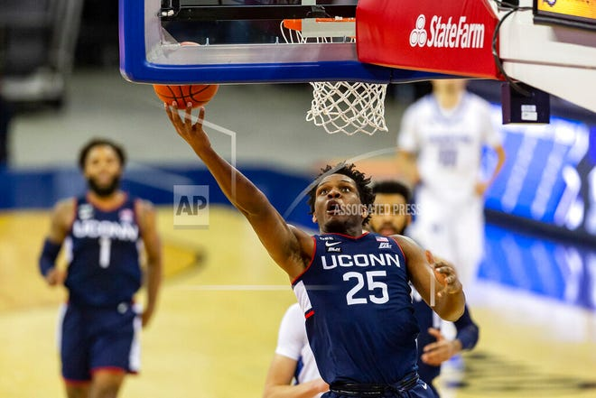 Connecticut forward Josh Carlton (25) drives to the basket for a layup against Creighton in the first half during an NCAA college basketball game Saturday, Jan. 23, 2021, in Omaha, Neb.