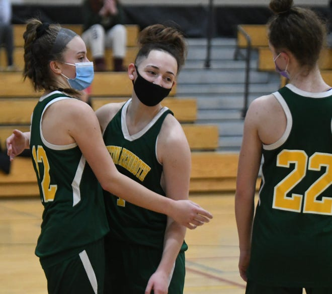 Dighton-Rehoboth's Emily D'Ambrosio, left, gets a hug by teammate Briana Malagutti after scoring her 1,000th point in a win against Somerset Berkley.