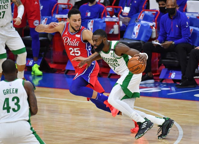 Celtics guard Jaylen Brown, who scored 42 points Friday night against the 76ers, drives to the basket against Philadelphia guard Ben Simmons during the second quarter.