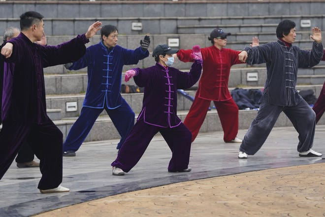 Residents practice tai chi Saturday at a park in Wuhan in central China's Hubei Province.