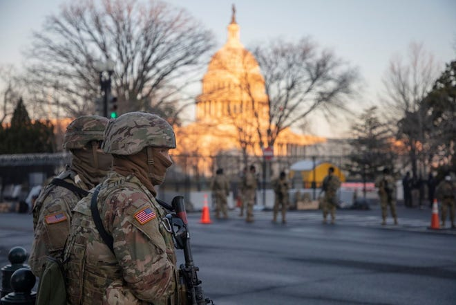 Soldiers from the Massachusetts Army National Guard provided security support outside the U.S. Capitol on Inauguration Day, part of the roughly 25,000 National Guard personnel dispatched to Washington to ensure a peaceful transfer of power Wednesday.