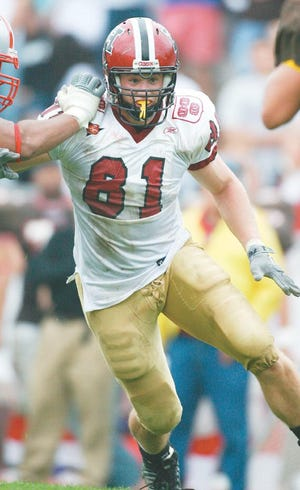 Former Wachusett Regional star Brad Bagdis is shown in action for Harvard, where he served as the football team's captain his senior year.