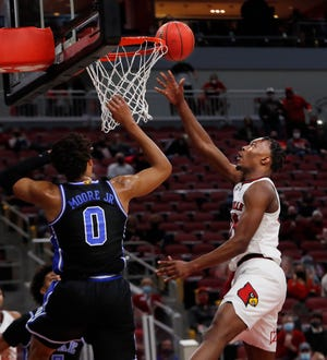 Louisville's Jae'Lyn Withers makes the bucket against Duke's Wendell Moore Jr.