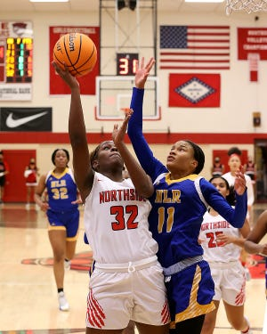 Northside's Haitiana Releford looks for the shot over North Little Rock's Arin Freeman in the second quarter, Friday, Jan. 22, at Kaundart-Grizzly Fieldhouse.