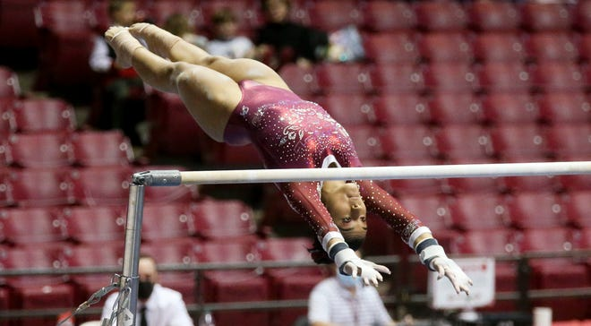 Luisa Blanco competes on the bars as Alabama gymnasts defeated Auburn Friday, Jan. 22, 2021. [Staff Photo/Gary Cosby Jr.]