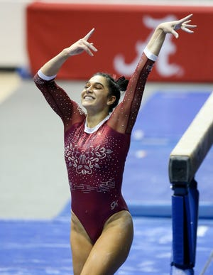 Alonza Klopfer nails her dismount from the beam as Alabama gymnasts defeated Auburn Friday, Jan. 22, 2021. [Staff Photo/Gary Cosby Jr.]