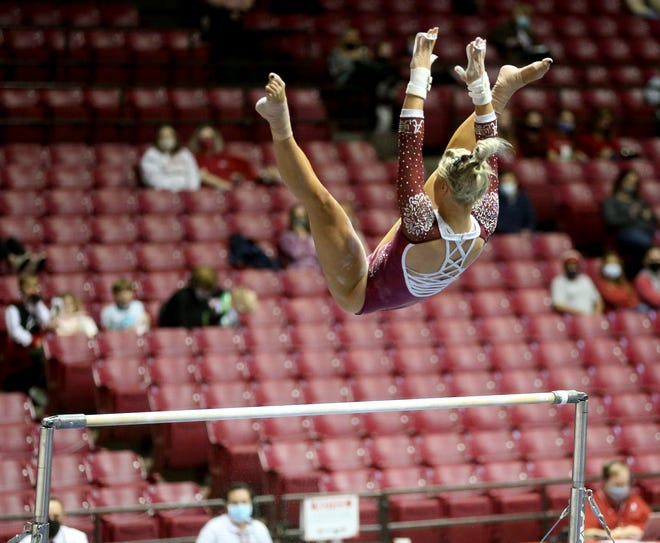 Jensie Givens competes on the bars as Alabama gymnasts defeated Auburn Friday, Jan. 22, 2021. [Staff Photo/Gary Cosby Jr.]