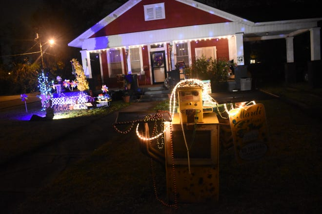 Alexandria Garden District residents D.C. Sills and Janice Williams decided to make a float in the front yard of their Polk Street home once they saw people in New Orleans decorating their houses as floats.